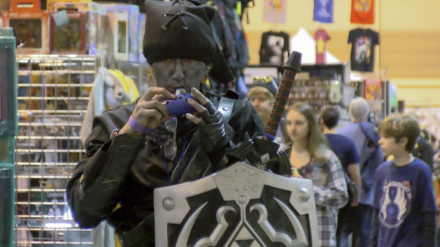 A cosplayer dressed up as Shadow Link from the video game
