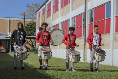 Members of the marching band practice at West Jefferson High School. West Jefferson teacher John Guzda said he has witnessed the effects of education inequality firsthand. Photo credit: Ver Lumod