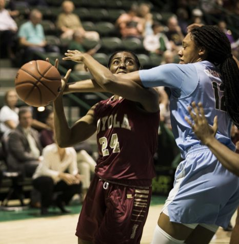 Breyah Richardson goes up for a contested layup in the first game of the year against Tulane University Green Wave on Oct. 30, 2019.  Tulane took the match, winning 61-38. Photo credit: Michael Bauer