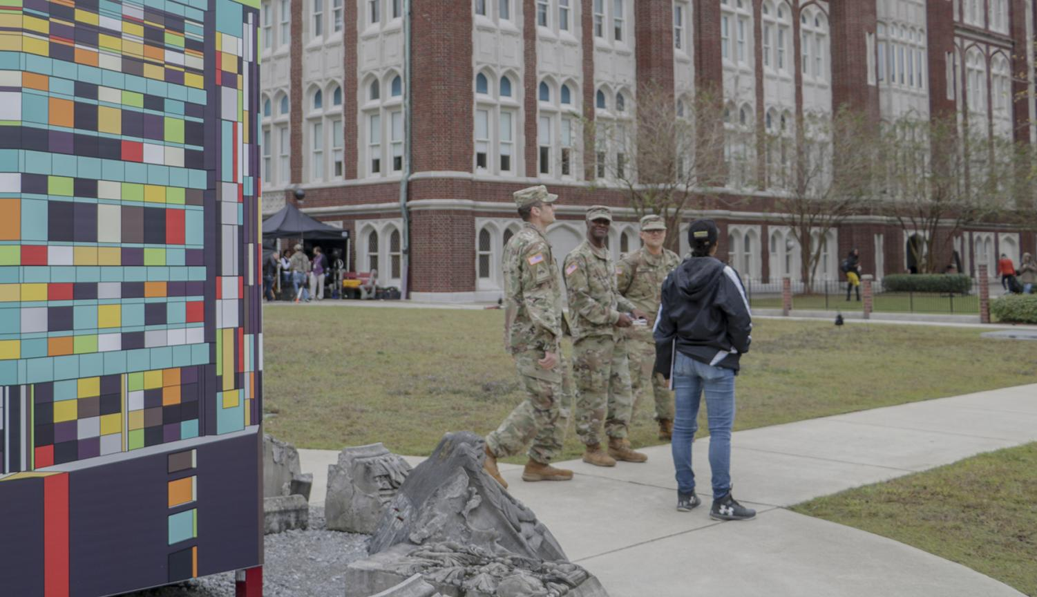 A commercial production filming on campus redesigns a Loyola sign for their set on Nov. 8 2019. The production sparked controversy when students and faculty reported hearing simulated gunshots. Hannah Renton/The Maroon. Photo credit: Hannah Renton