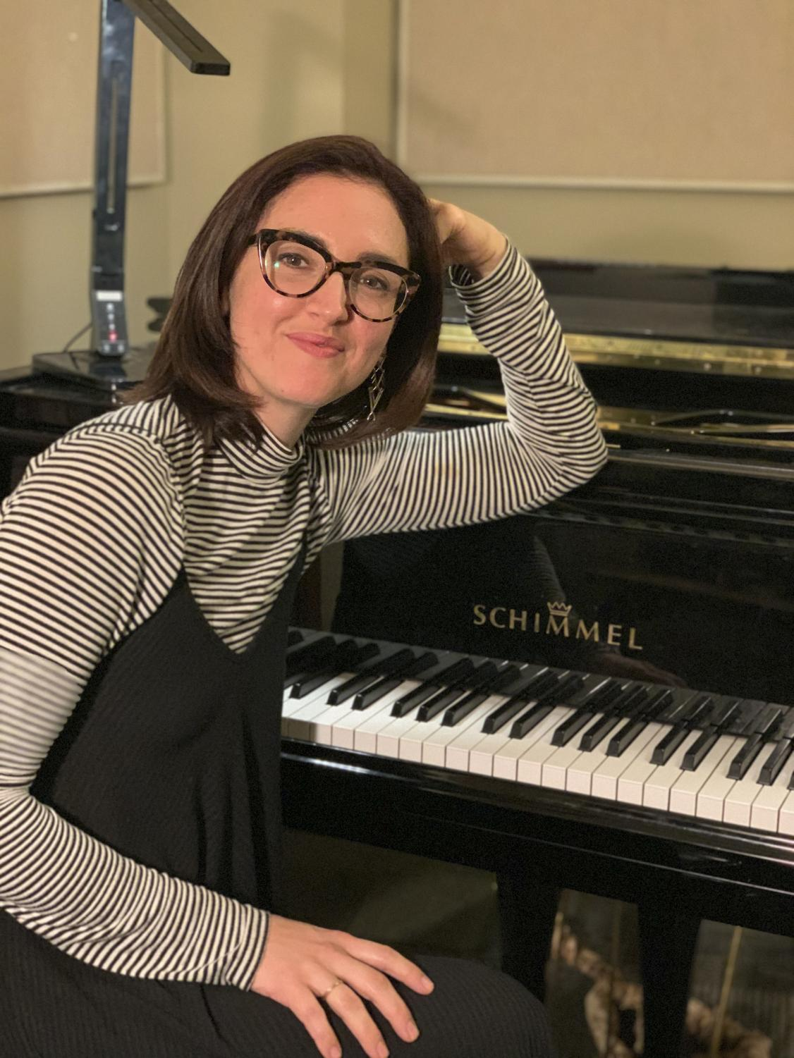 Jenna McSwain, popular and commercial music professor, poses for a portrait. She loves the inspiration in the college setting. Photo credit: Sofia Santoro