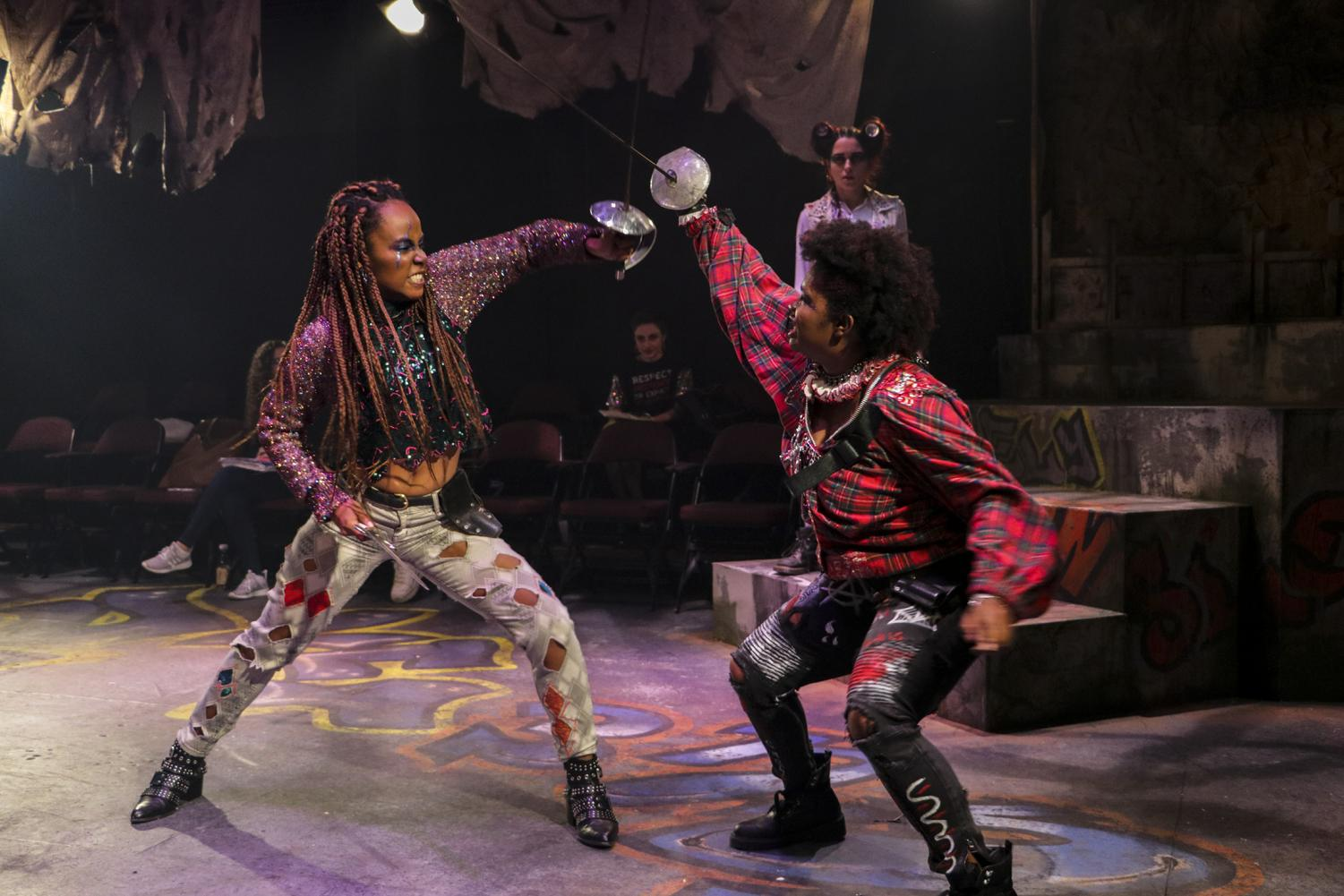 Talia Moore, musical theater senior, performs a fight scene as Mercutio alongside Tybalt played by Cereyna Jade Bougouneau, theater senior. Loyola's Theatre Department will present their production of an all-female Romeo & Juliet beginning Nov. 8, 2019. Photo credit: Hannah Renton