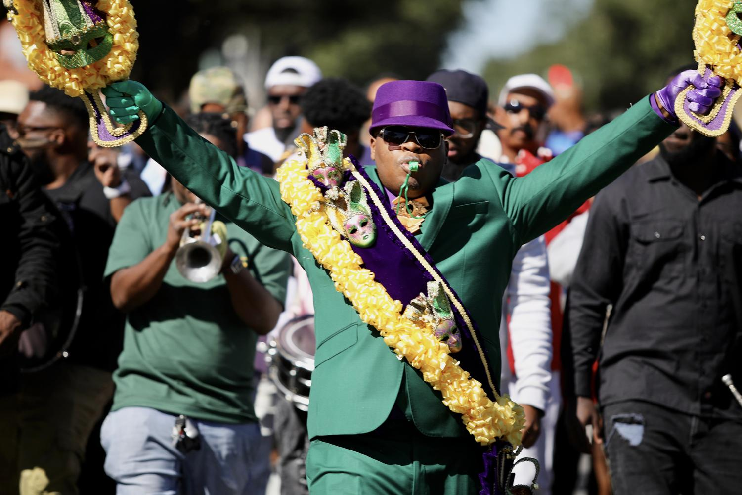 A member of the We Are One court marching in Mardi Gras colors on St. Charles St. on Nov. 3, 2019.