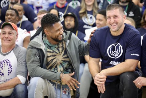 Usher and Tim Tebow pose ahead of their volunteer work at Einstein Charter on December 31, 2019. Photo credit: Rhon Ridgeway