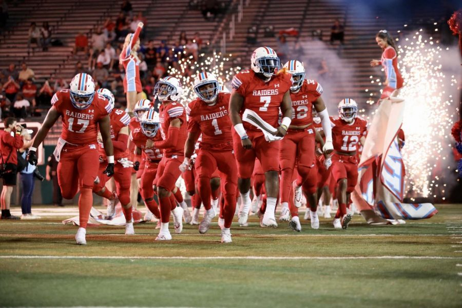 The Archbisop Rummel High School football team rushes onto Yulman Stadium to play Catholic High for the LHSAA Division 1 state championship on Dec. 6, 2019. Photo credit: Andres Fuentes