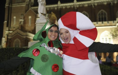 Students pose in their tree and candy cane costumes at Sneaux. Sneaux took place in Loyola University's Horeshoe on Tuesday Dec. 3rd, 2019. Photo credit: Hannah Renton