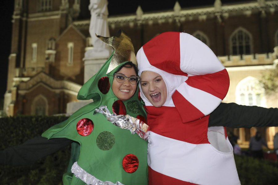 Students pose in their tree and candy cane costumes at Sneaux. Sneaux took place in Loyola University