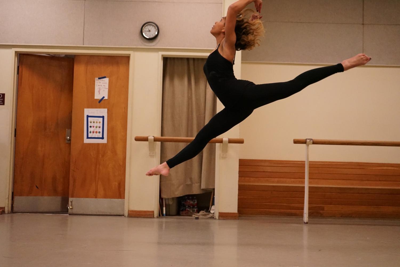 Andi Robinson practicing a solo dance routine in Loyola's dance studio.