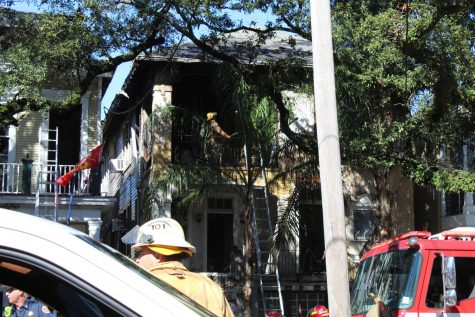 Firefighter extinguish fire at multi-family home.