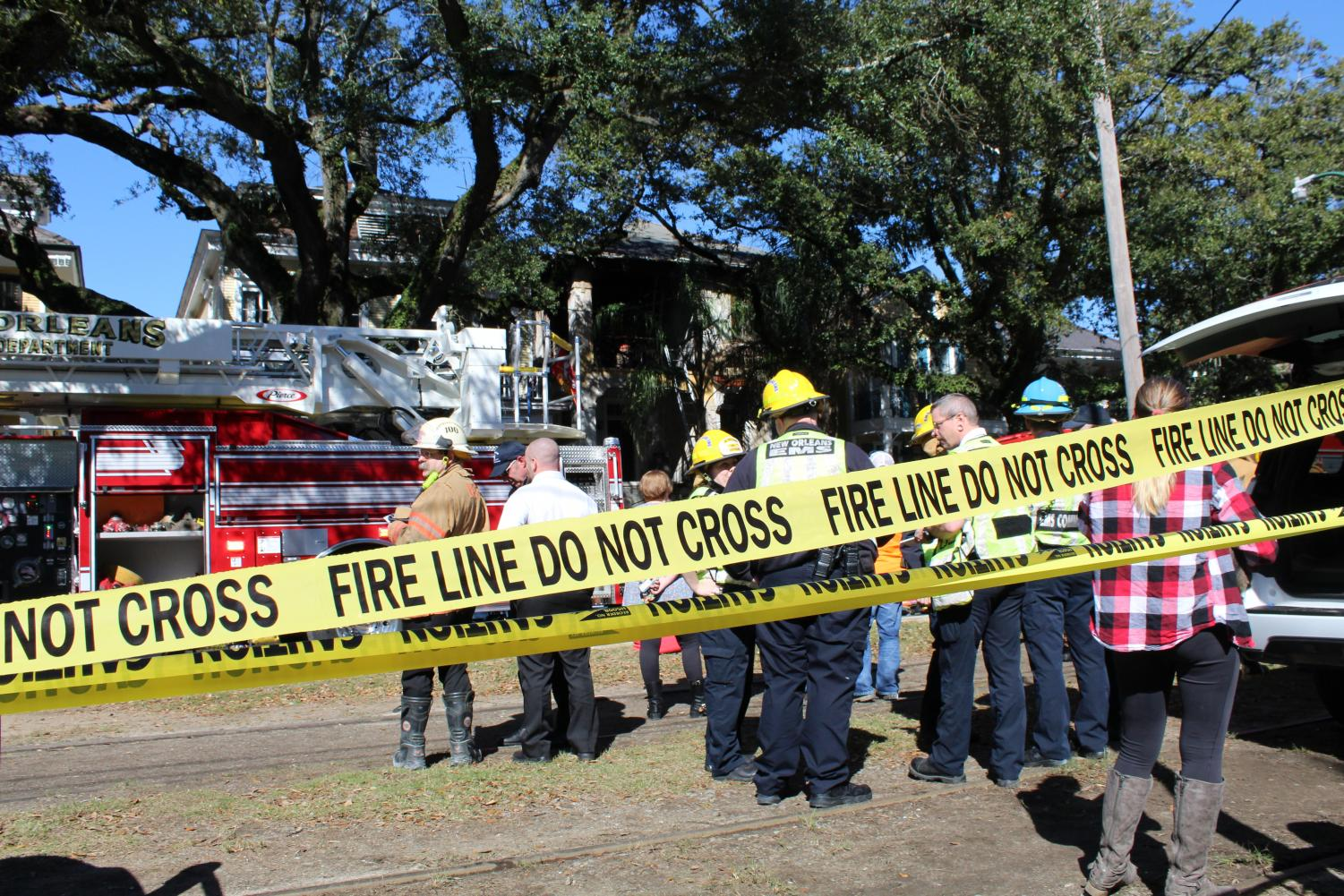 New Orleans Fire Department responds to a four-alarm fire  on the 2300 block of St. Charles Avenue on Jan. 24. Two people were transported to the hospital and the cause of the fire is still under investigation.