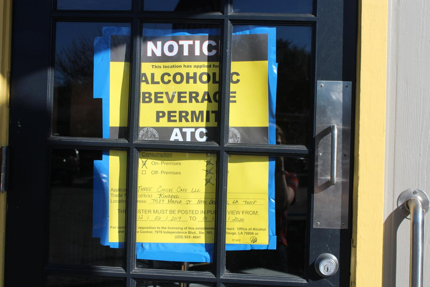 An alcoholic beverage permit approved by the city is displayed on the front door of the newly opened restaurant Kindred on Maple Street in Uptown on Jan. 8. In the aftermath of the Dec. 13 cyberattack on New Orleans City Hall, all city permits are being processed by hand.