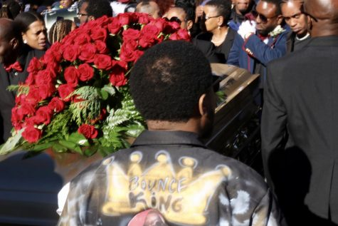 Mourners carry 5th Ward Weebie's casket.