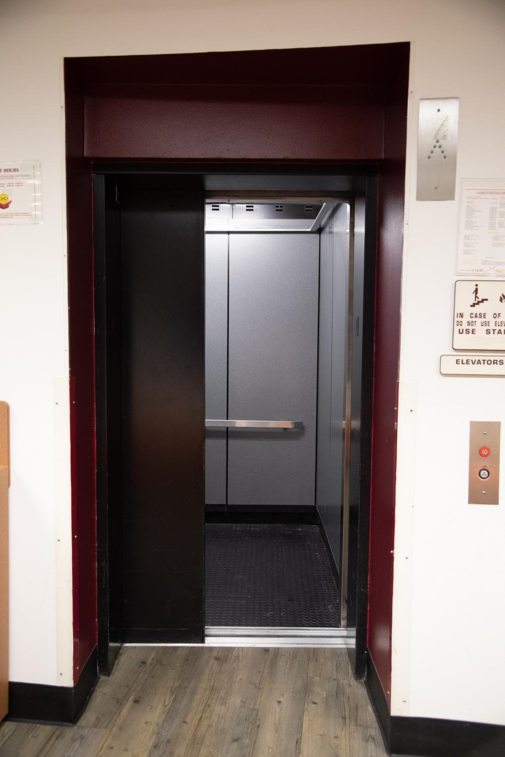 An elevator opens it doors in Carrollton Hall. Loyola elevators broke down 62 times in 2019, but authorities say the university is following state inspection policies. Photo credit: Michael Bauer