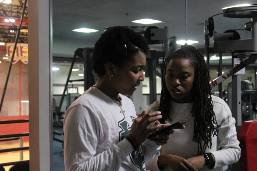 Coach Bryiana Richardson helps criminal justice freshman Morgan Wakefield at track and field practice in the University Sports Complex on Friday, Jan. 10, 2020.