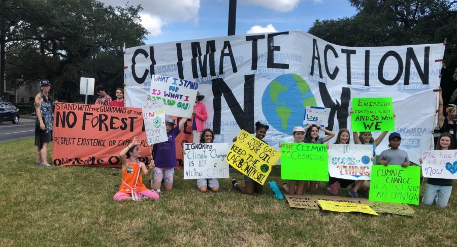 Activists protest on the median of St.Charles and Napoleon during  the International Climate Strike on  Sept. 20, 2019.