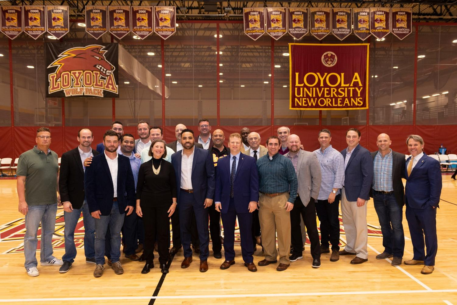 2020 inductees to the Wolf Pack Athletic Hall of Fame gather during halftime at a basketball hall of fame game . Those pictured were inducted officially at the ceremony Jan. 18, 2020. Courtesy of Kyle Encar