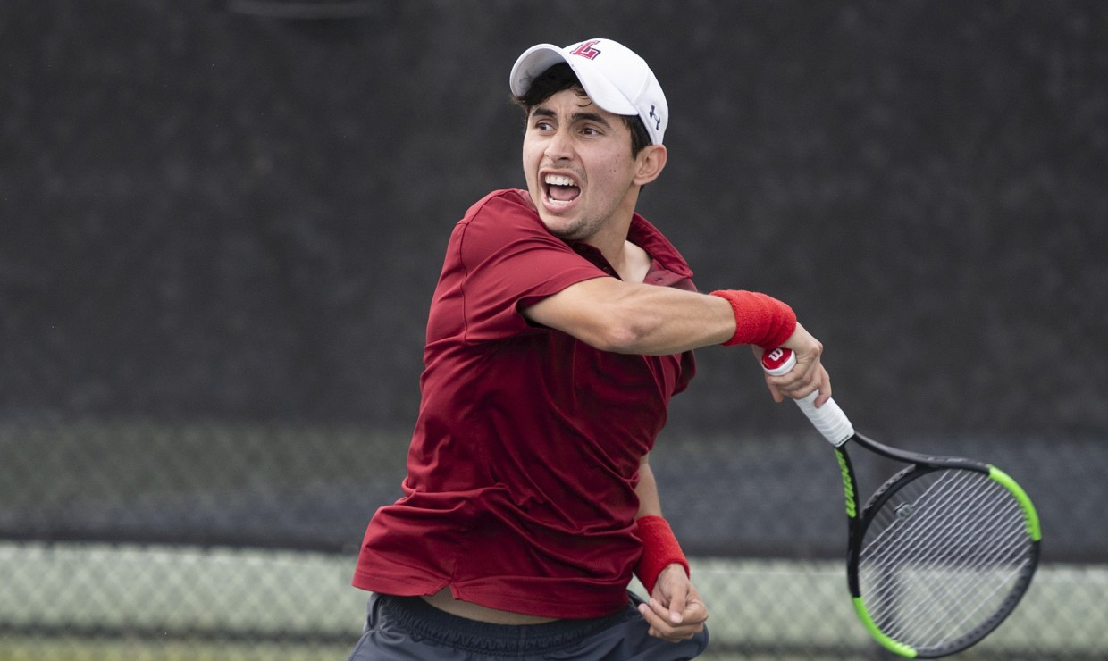 Men's tennis player Ernesto Telles, from San Salvador, El Salvador, battles in match against Jackson State Jan. 25. Telles is one of many international students in the tennis program.