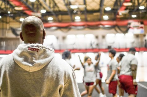 Coach Rickey Hill looks on at team practice.  Hill has coached at Loyola since 2016. Photo credit: Gabrielle Korein