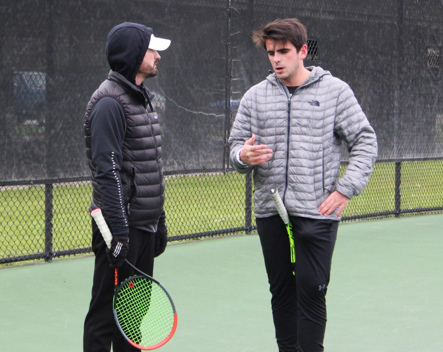 Coach Matthew Llewelyn speaks to player Emilio Saenz at team practice. Wolf Pack athletics hired Llewelyn last November.