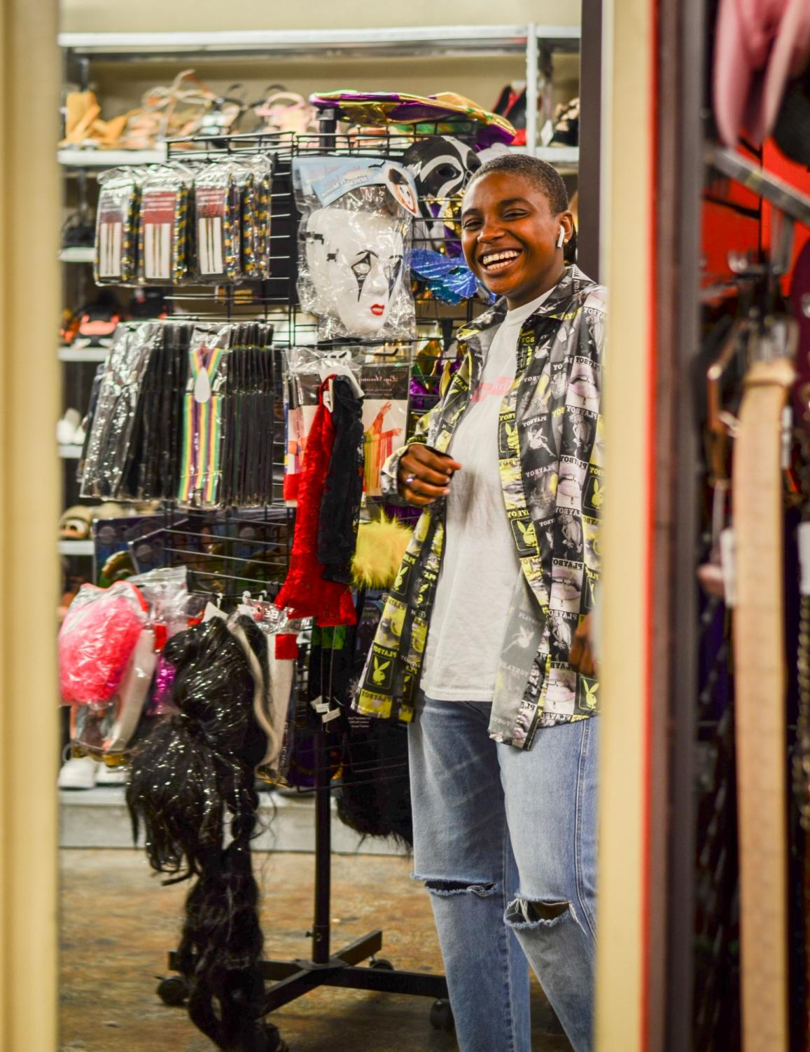Philosophy Freshman Jeovanna deShong-Conner looks in the mirror at New Orleans Buffalo Exchange, wearing thrifted clothes.