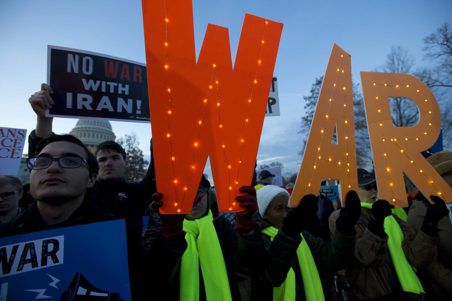 Demonstrators protest outside of the U.S. Capitol, during a house vote to measure limiting President Donald Trump's ability to take military action against Iran, on Capitol Hill, in Washington, Thursday, Jan. 9, 2020. (AP Photo/Jose Luis Magana)