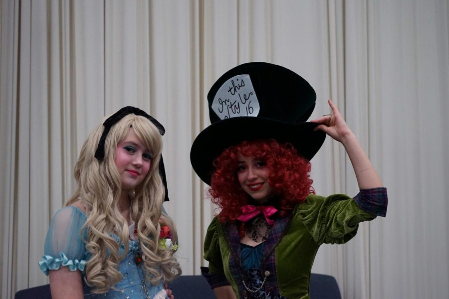 Lily Maddox (left) and Lily Barber (right) cosplay as Alice and the Mad Hatter respectively on Jan. 4, 2020. The event lasted for three days and featured live music, performances, artists, guest celebrities and more.