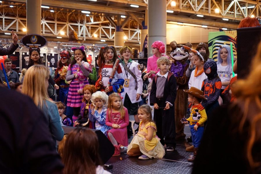 Cosplaying children all pose for a photo after the Children Costume Competition on Jan. 4, 2020. All children that competed won and were offered awards afterward.