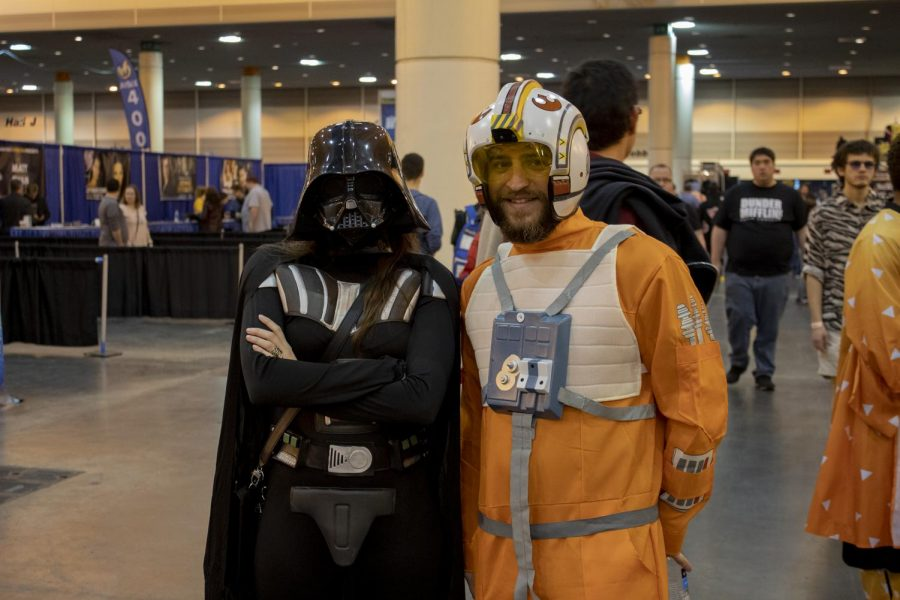 Sydney Doyle (left) and Dane Schnider (right) cosplay as Darth Vader and an X-Wing Pilot respectively on Jan. 4, 2020. The event lasted for three days and featured live music, performances, artists, guest celebrities and more.