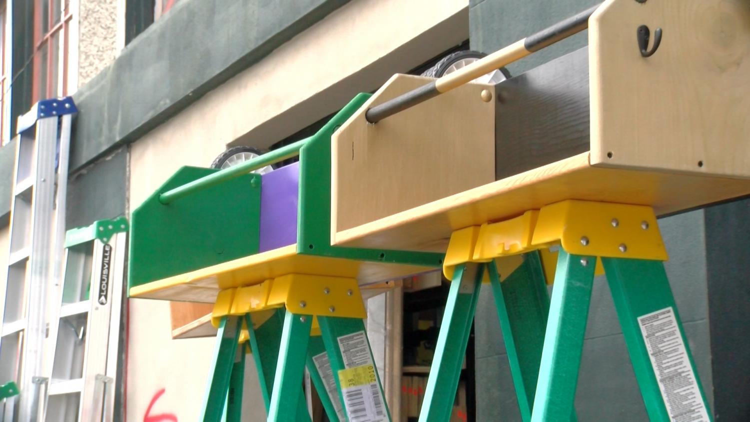 Two ladders stand by the sidewalk. Due to new regulations from New Orleans City Council, ladders must be removed from the parade route.