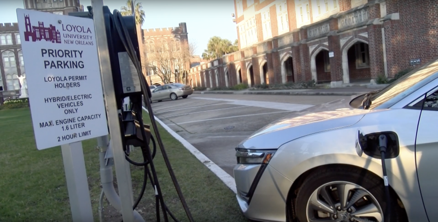 An+electric+car+owner+charges+his+car+in+front+of+Loyola+University+New+Orleans.+Charging+stations+in+various+New+Orleans+locations+have+been+used+to+promote+going+green.