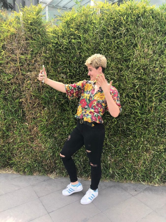 Aly Hetzel records herself doing a TikTok. Her account, @cajunqueer, reaches over 50,000 every post.