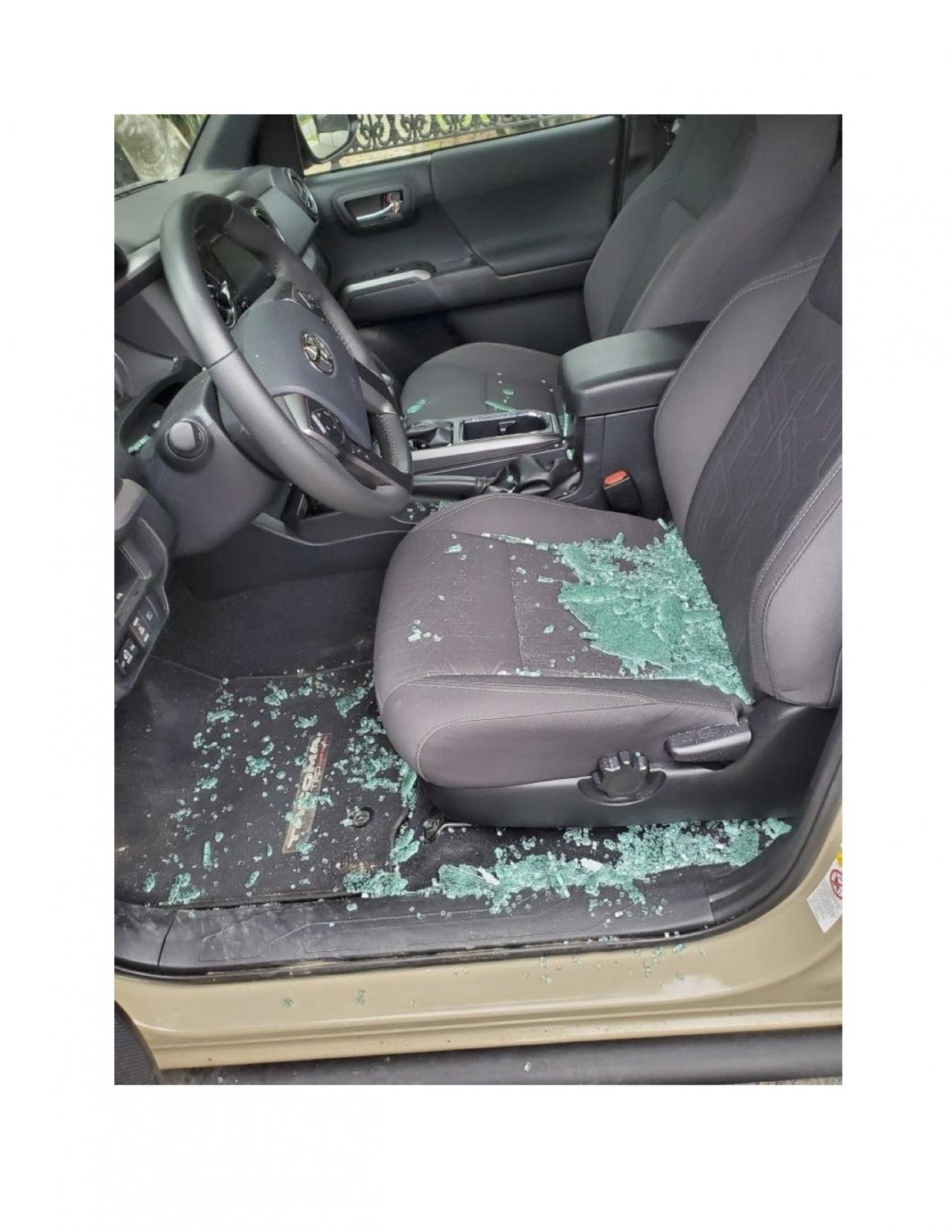 Glass from the smashed driver's side door of Dustin Walker's car lays scattered across the inside of the car.This was the third time Walker's car was broken into in Uptown New Orleans.