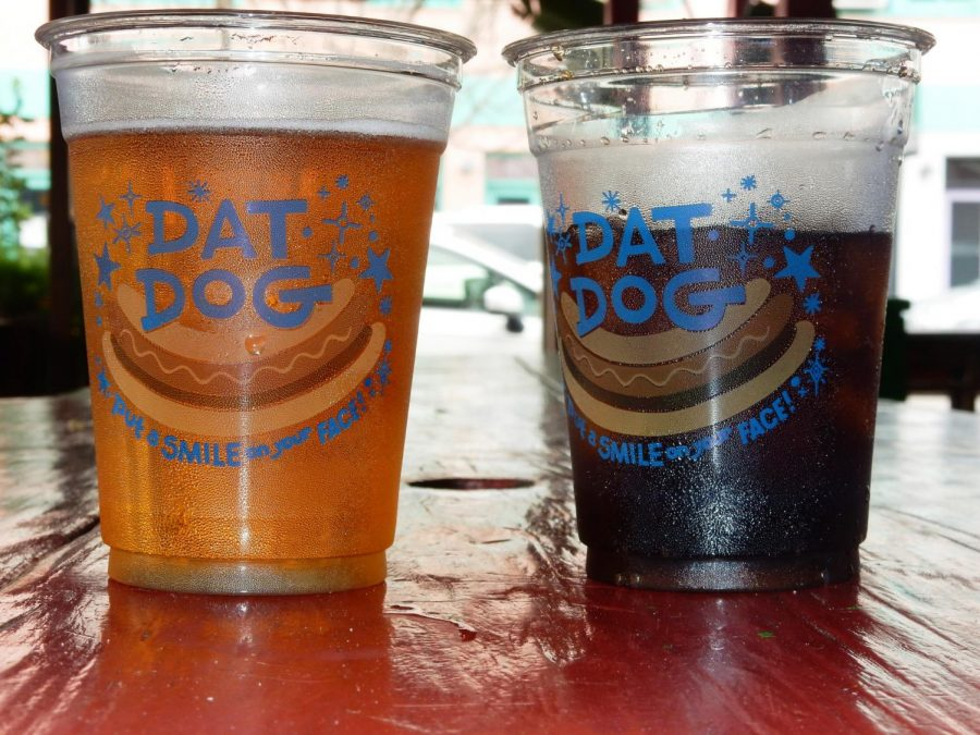 A+beer+and+soda+sit+on+a+table+at+Dat+Dog.+Dat+Dog+has+two+locations+Uptown.+Photo+credit%3A+Shadera+Moore