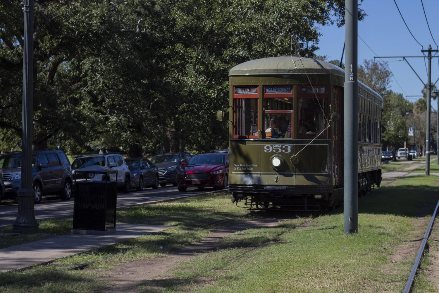A not in service streetcar speeds by on St Charles Avenue. Loyola's Department of Student Life and Ministry is now providing jazzy passes for the streetcar. Photo credit: Cristian Orellana