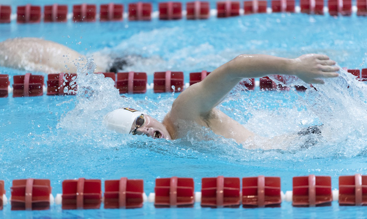 Sophomore Jack Johnson swims during an NAIA competition. The swim team's next contest is Feb. 6-8. Courtesy of loyolawolfpack.com.