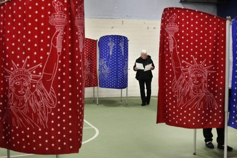 A voter checks her ballots after coming out of a booth while voting in the primary election, Tuesday, March 3, 2020, in Mechanic Falls, Maine. Voters in Louisiana will have to wait until June to cast their primary ballots, as the state delayed its primaries in the wake of the COVID-19 outbreak (AP Photo/Robert F. Bukaty)
