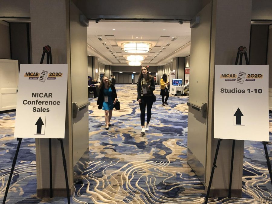 Conference attendees walking through a hallway