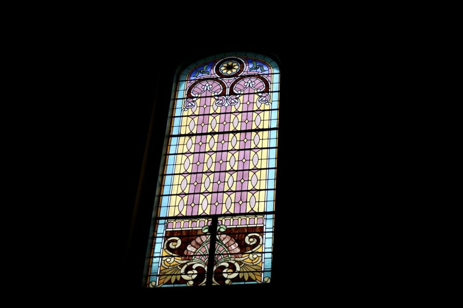 A stained glass window reflects light into St. Louis Cathedral on March 23, 2020. The cathedral held a live-streamed mass in the wake of the COVID-19 outbreak.