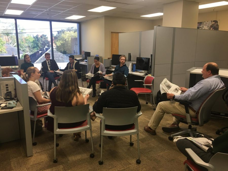 The Maroon staff critiques the paper copy in the Maroon office on Friday, March 6. The papers Editor-in-Chief has been placed under self-quarantine after coming in contact with someone who has tested positive for COVID-19.