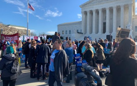 Protesters gather outside the Supreme Courthouse in Washington D.C. on Wednesday, March 4. Hundreds gathered as the Court began oral arguments in a case regarding a Louisiana abortion law. Lily Cummings/ The Maroon.