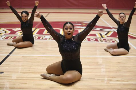 Loyola dance team members perform their conference routine. The dance team placed second out of five teams and earned a chance to compete in the 4th annual National Alliance of Intercollegiate Athletics National Championships. Photo credit: Andres Fuentes