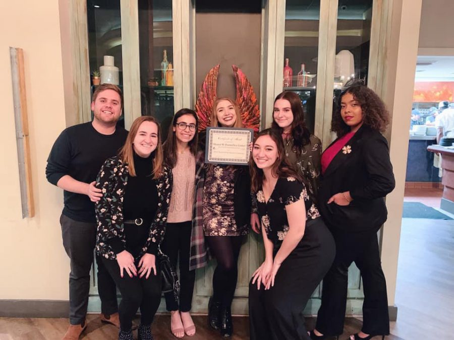 Students who work at the Donnelley Center pose with an award they won. Professor Alvaro Bootello said that Loyola plays an important role in the New Orleans public relations industry. Courtesy of the Donnelley Center.