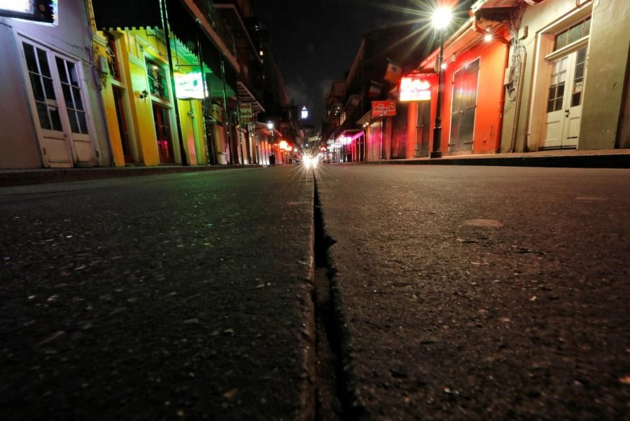 In this Thursday, March 19, file photo, a view of the nearly deserted scene on Bourbon Street, which is normally bustling with tourists at restaurants and bars. Due to the coronavirus outbreak, New Orleans has shut down bars and eliminated restaurant dining, leaving local servers out of work. (AP Photo/Gerald Herbert, File)