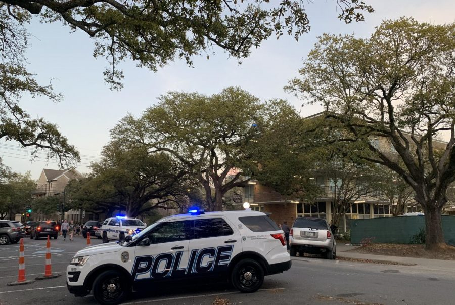 A Tulane University Police car sits outside of Phelps House residential hall on the evening of Thursday, March 12. The police presence came after reports of a student jumping off of the stairwell outside the building. A Tulane sophomore was reported dead of a 'apparent accident' later in the day.