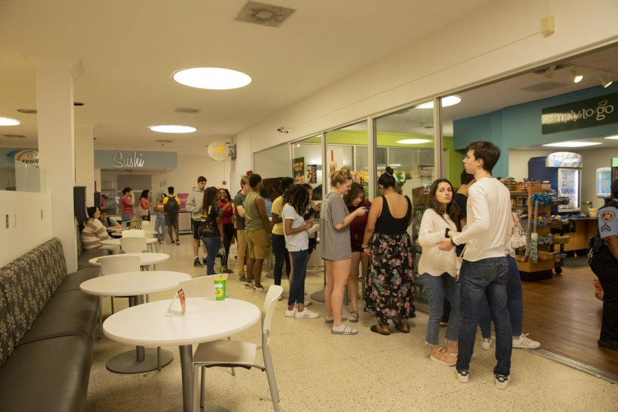 Groups of students wait for the Sea Store on March 11, 2020 after classes were moved online.