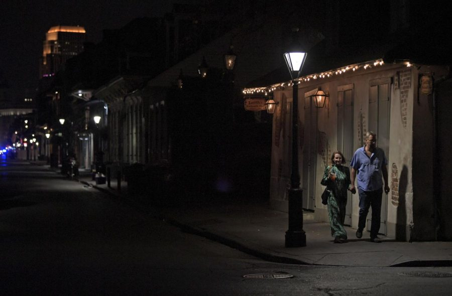 A+couple+walks+past+Lafitte%27s+Blacksmith+Shop%2C+known+as+the+oldest+bar+in+the+United+States+dating+back+to+the+1700s%2C+which+is+closed+due+to+an+order+from+Louisiana%27s+Governor+John+Bel+Edwards+to+shut+bars+and+restaurants+state-wide+to+limit+the+spread+of+the+coronavirus+pandemic+on+Bourbon+Street+in+New+Orleans%2C+La.%2C+Monday%2C+March+16%2C+2020.%28Max+Becherer%2FThe+Advocate+via+AP%29