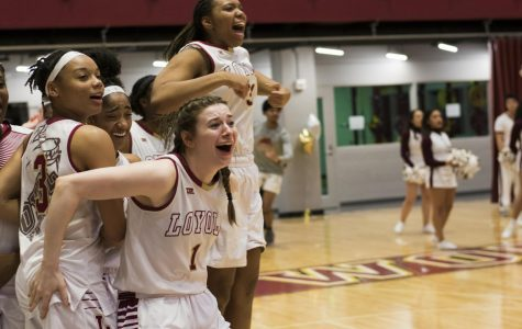 Accounting senior Paige Franckiewicz and the women's team celebrate during a regular season game. Their final season was cut short amid the COVID-19 outbreak. Photo credit: Michael Bauer