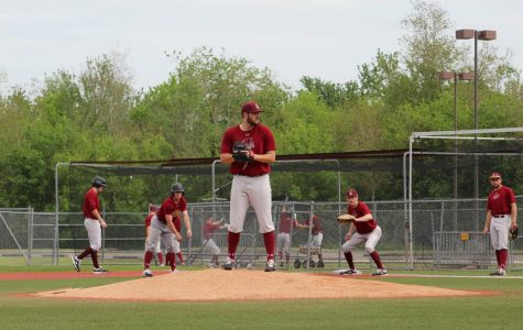 Pitcher Wes Anderson comes to a set as Wolfpack baseball goes over bunt defense. Photo credit: Andrew Wellmann