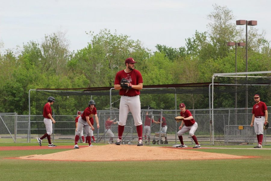 Pitcher+Wes+Anderson+comes+to+a+set+as+Wolfpack+baseball+goes+over+bunt+defense.+Photo+credit%3A+Andrew+Wellmann
