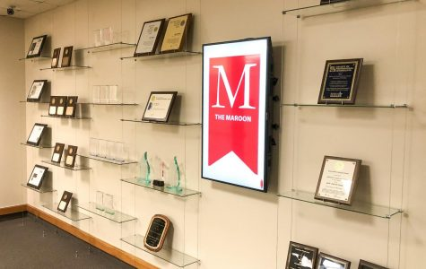 The shelf outside of The Maroon office sits filled with awards.